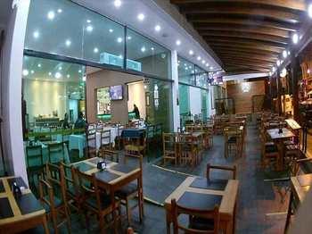 Restaurante, código 54561200 em São Vicente, bairro Itararé