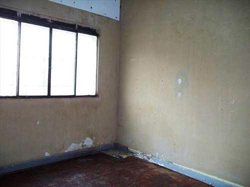Casa, código 10084000 em São Vicente, bairro Centro