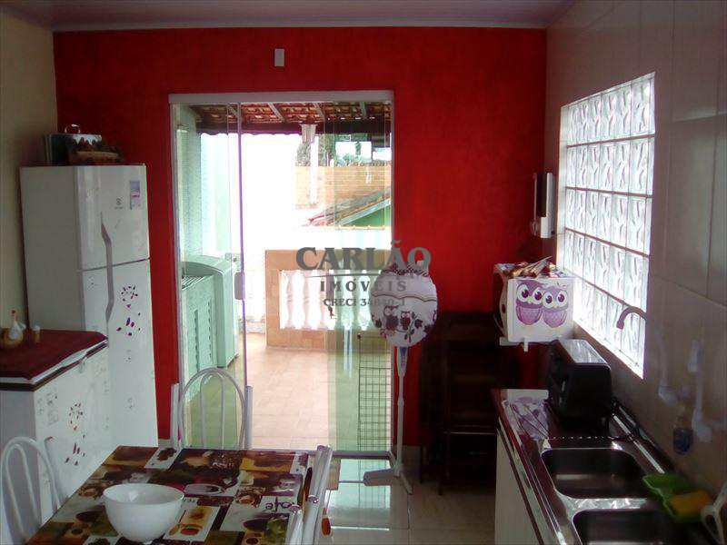 Sobrado em Mongaguá, bairro Conjunto Regina Maria