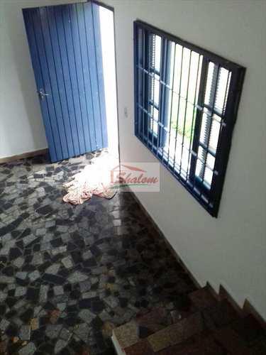 Sobrado, código 989 em Caraguatatuba, bairro Jardim Aruan