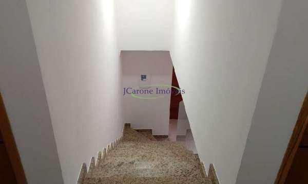 Casa com 4 dormitórios à venda, 210 m² por R$ 1.100.000 - Campo Grande - Santos/SP