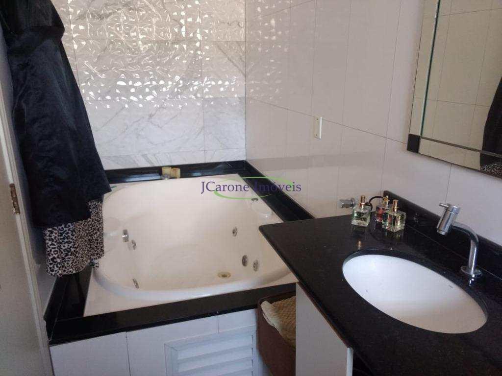 Casa com 3 dormitórios à venda, 242 m² por R$ 1.180.000 - Aparecida - Santos/SP